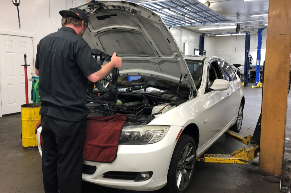 Image of a mechanic working on engine cooling system